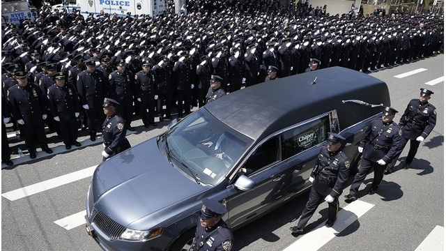 At New York officer's funeral, police reflect on tough time