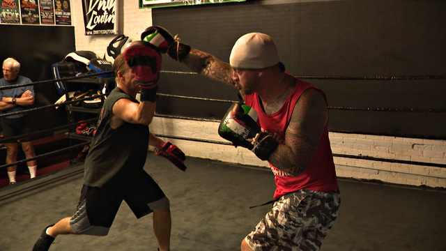 hitting a heavy bag instead of the bottle boxer inspires others to