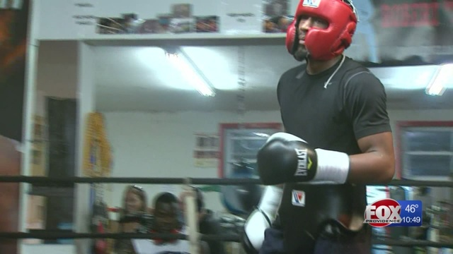 Police: Boxing champion arrested for carrying gun without permit